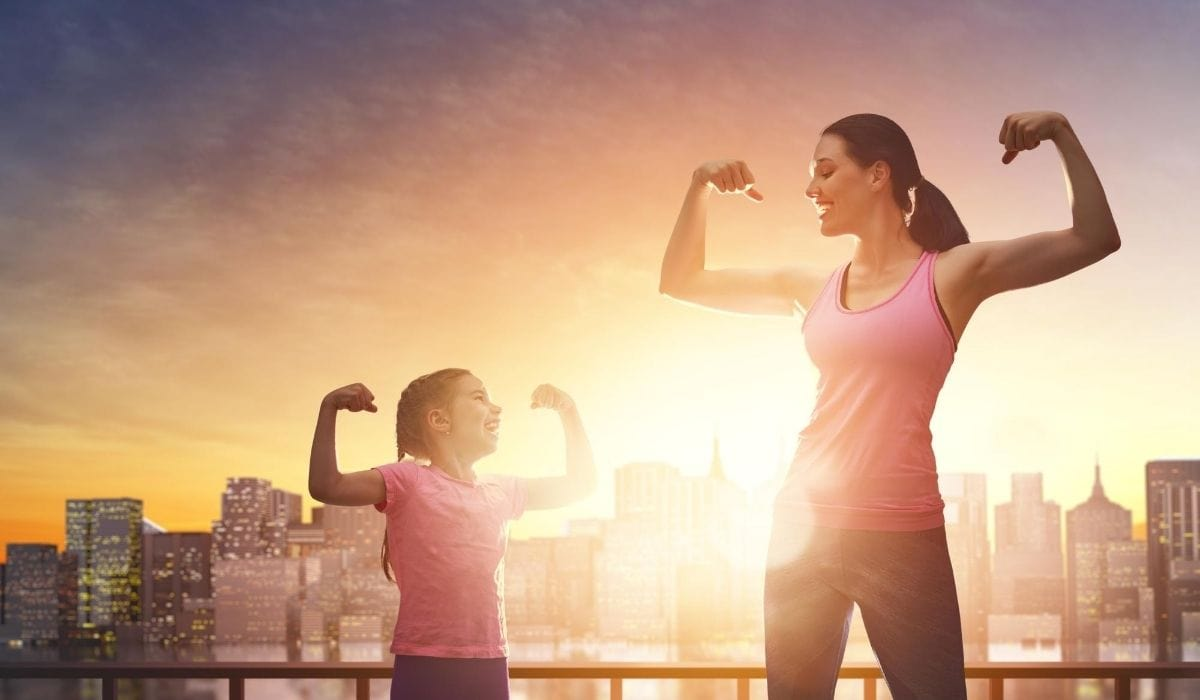 daughter and mother physically fit