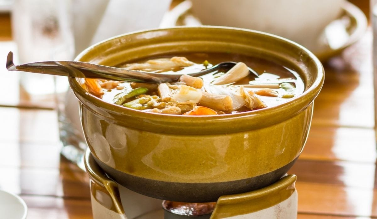 thai style sweet and sour fish soup in a bowl
