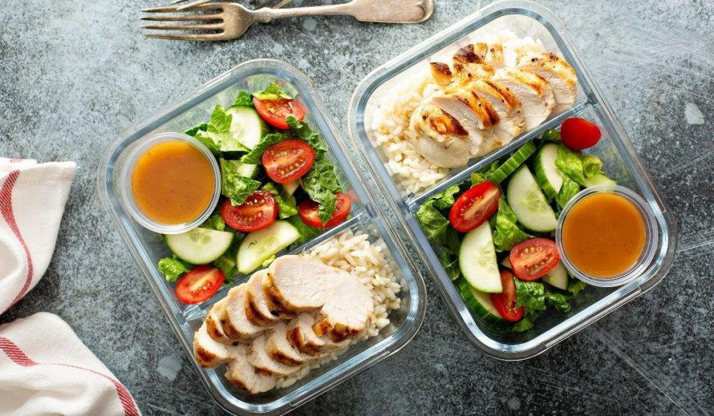 meal prep - grilled chicken and rice with salad on the side