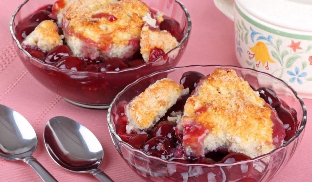 two glass bowls of cherry cobbler