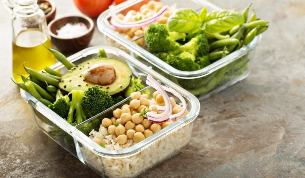 vegan meal prep container with rice, chickpeas, brocolli, avocados